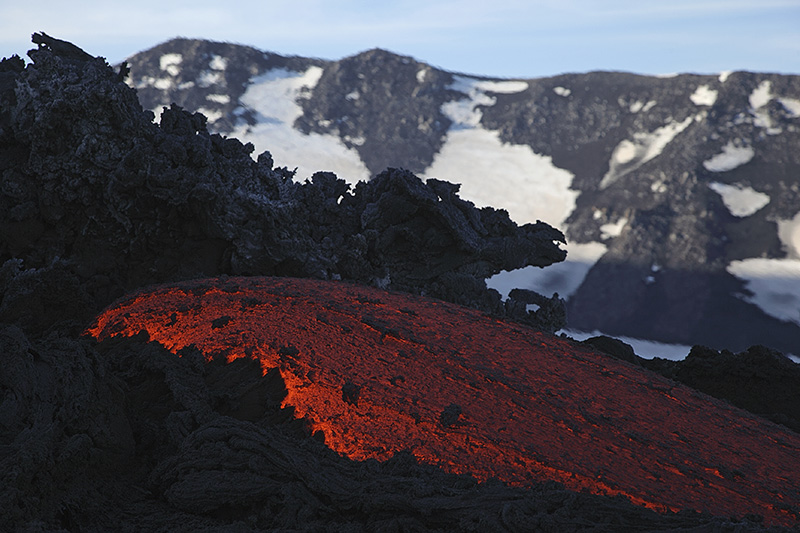 A lava flow on the snowy volcano