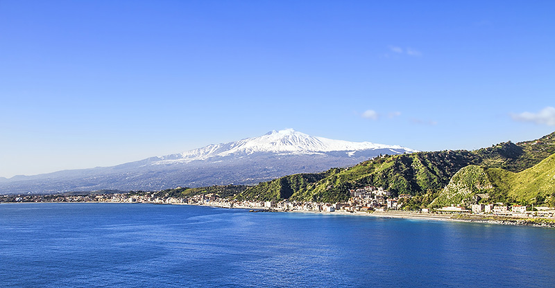 The snowy peak of Mount Etna seen from Taormina