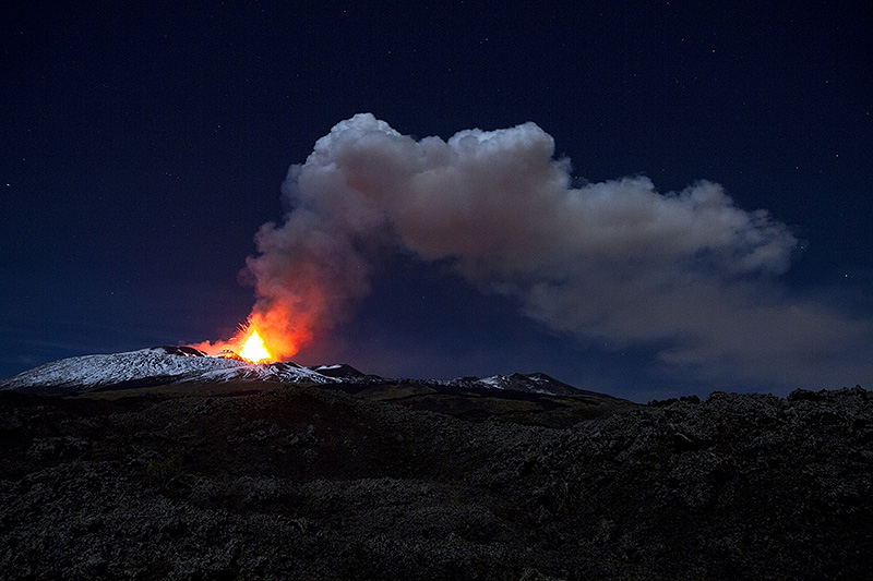A volcanic eruption in the night