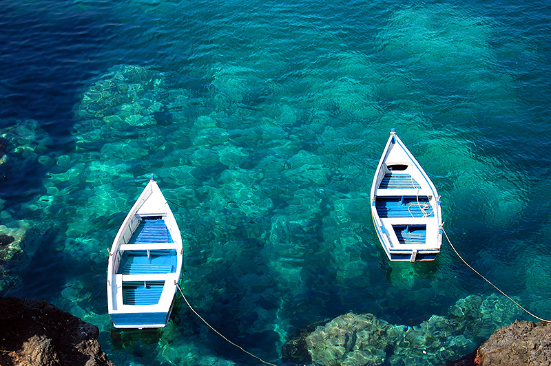 Two boats in the sea near Acicastello