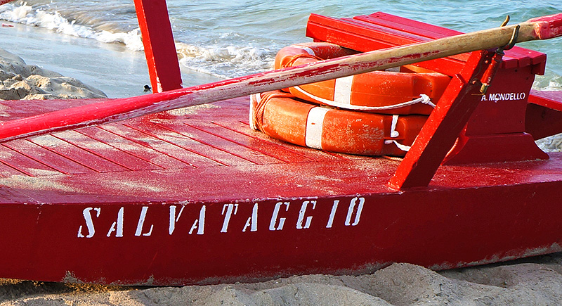 A red lifeboat on the beach of Mondelloo