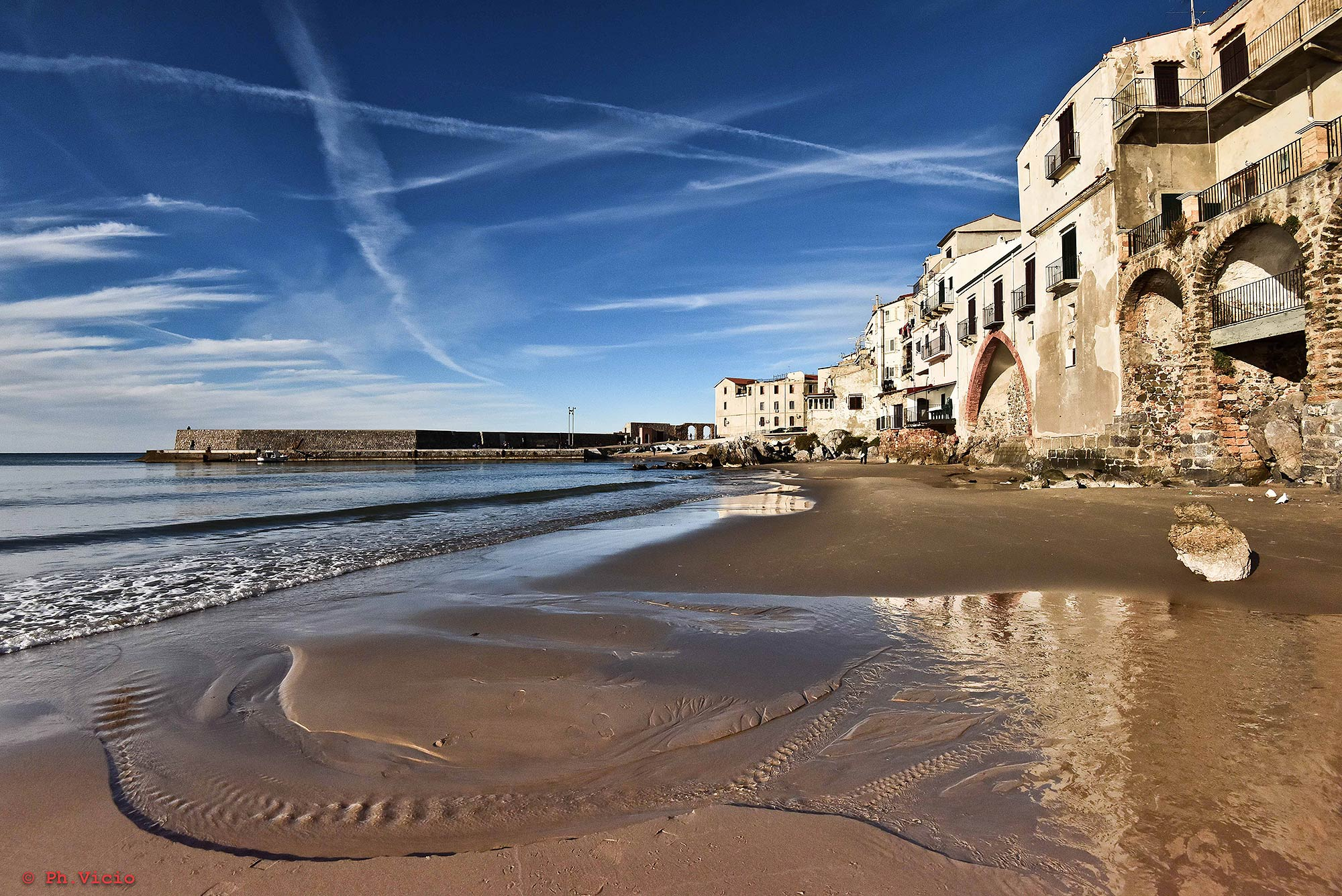 On the beach of the Sicilian coastal town of Cefalù